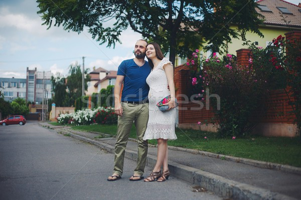 Young attractive couple: pregnant mother and happy father Stock photo © vizarch