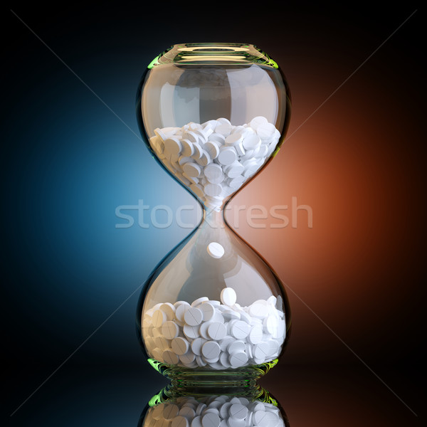 Sand Clock With Pills In Black Studio With Artistic Backlight Stock photo © vizarch