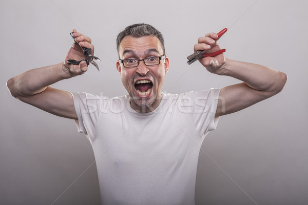 man with two pliers in his hands Stock photo © vizualni