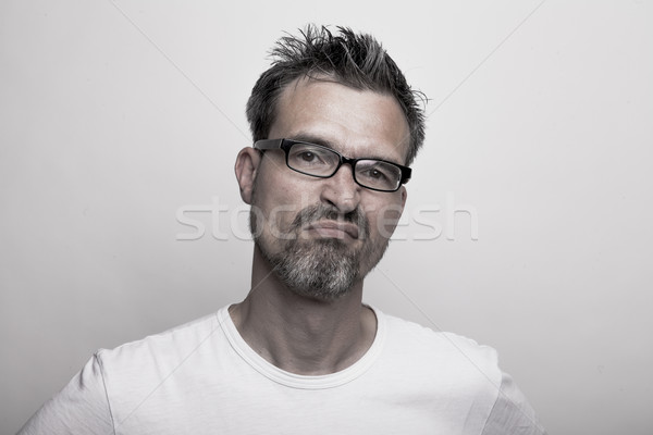 slightly annoyed man Stock photo © vizualni