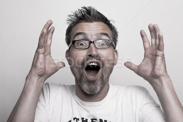 Portre şaşırmış adam yukarı eller gözlük Stok fotoğraf © vizualni