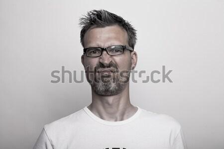 Happy man holds one thumb up Stock photo © vizualni