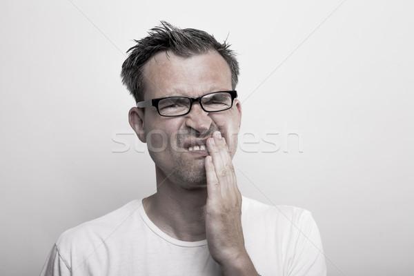Homem dor de dente retrato inferno óculos dentes Foto stock © vizualni