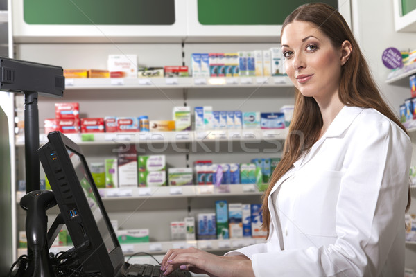 Pharmacist at the cash desk Stock photo © vizualni