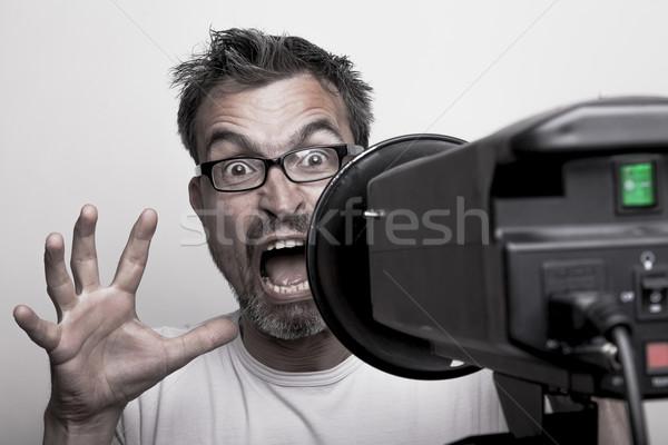 Endişeli erkek fotoğraf model arkasında stroboskop Stok fotoğraf © vizualni
