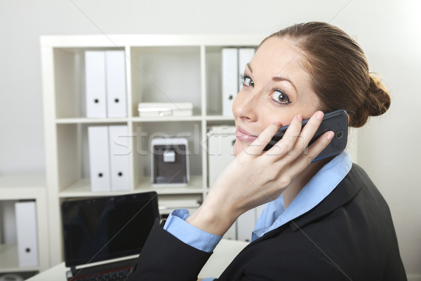 Businesswoman has a call Stock photo © vizualni
