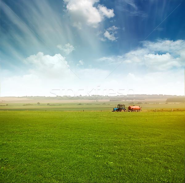 tractor in  field gather crops Stock photo © vkraskouski