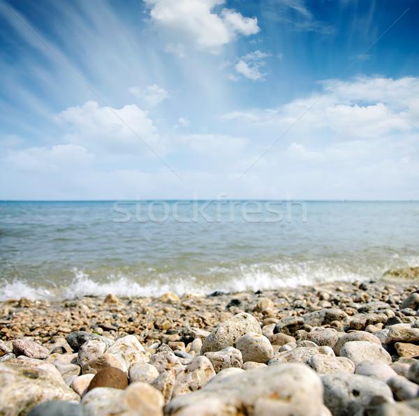 Deniz dalga bulutlu gökyüzü sahil taşlar Stok fotoğraf © vkraskouski