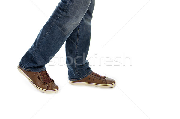 male legs in jeans and brown sneakers shoes Stock photo © vkraskouski