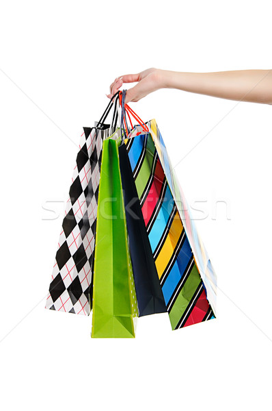 Stock photo: woman hand with shopping bags