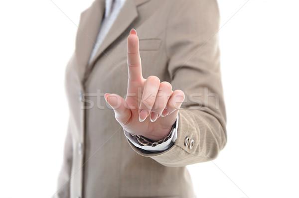 стороны костюм прикасаться что-то пальцы женщины Сток-фото © vkraskouski