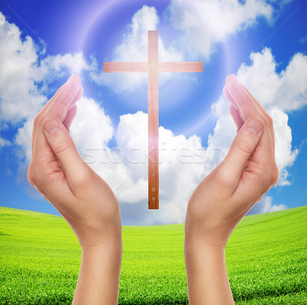 hands praying with cross in sky - easter concept Stock photo © vkraskouski