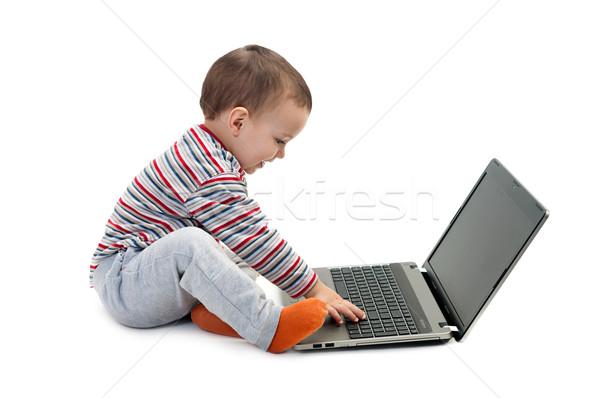 Vidám fiú laptop izolált kicsi mosolyog baba Stock fotó © vkraskouski