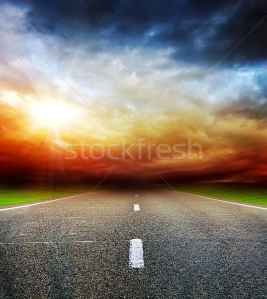 road in field over stormy dark cloudy sky Stock photo © vkraskouski