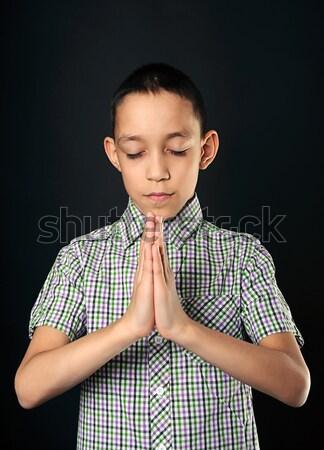 Imádkozik fiú csukott szemmel fekete portré visel Stock fotó © vkraskouski