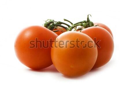 tasty tomatoes isolated over white Stock photo © vkraskouski