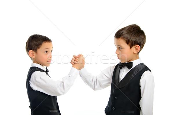 Tweelingen spelen arm worstelen geïsoleerd twee broers Stockfoto © vkraskouski