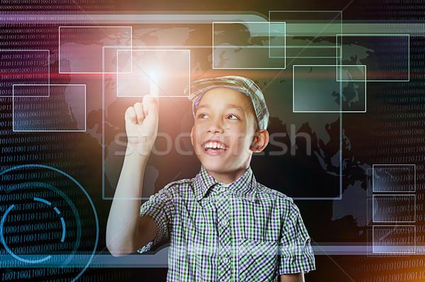 Fiú érintés virtuális gomb háló fiatal srác Stock fotó © vkraskouski