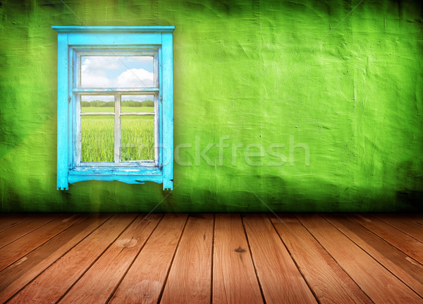 room with window with field and sky above it  Stock photo © vkraskouski