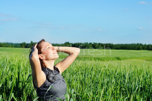 woman with hands raised up in the wheat field Stock photo © vkraskouski