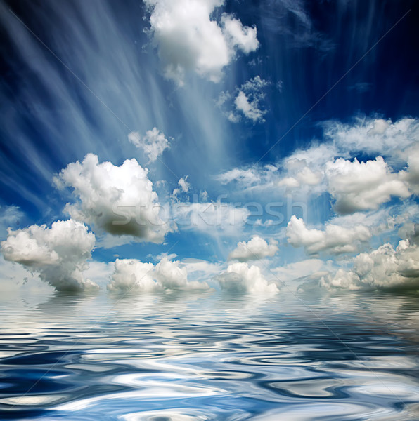 stormy sky reflected in water waves Stock photo © vkraskouski