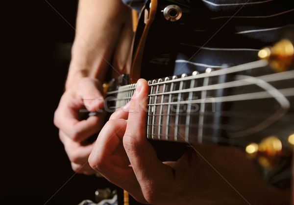 guitarist hands playing guitar over black Stock photo © vkraskouski