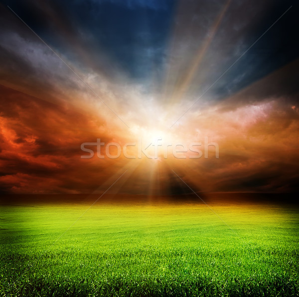 Stock photo: dark evening sky and green field