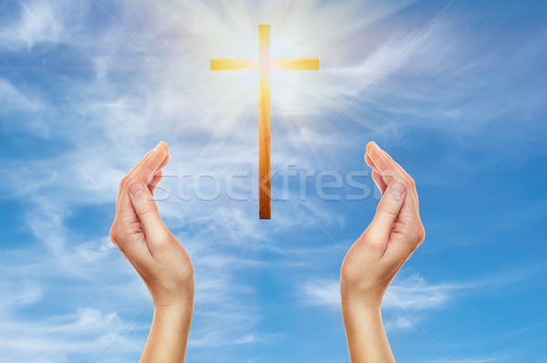 hands praying with a wooden cross Stock photo © vkraskouski