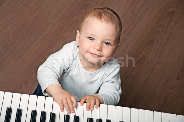 baby play black and white piano Stock photo © vkraskouski