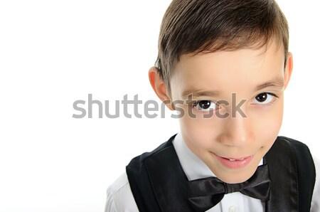 Schooljongen zwart pak bruine ogen naar camera portret Stockfoto © vkraskouski