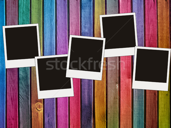 colorful wooden wall with blank photos      Stock photo © vkraskouski