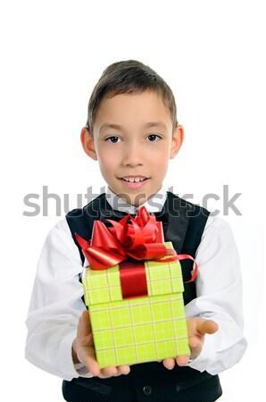 Erkek siyah takım elbise yeşil hediye kutusu yalıtılmış Stok fotoğraf © vkraskouski