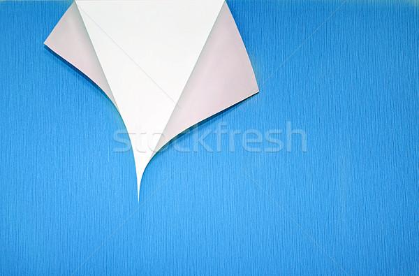 Kâğıt kıvırcık köşe bo mavi duvar kağıdı Stok fotoğraf © vkraskouski