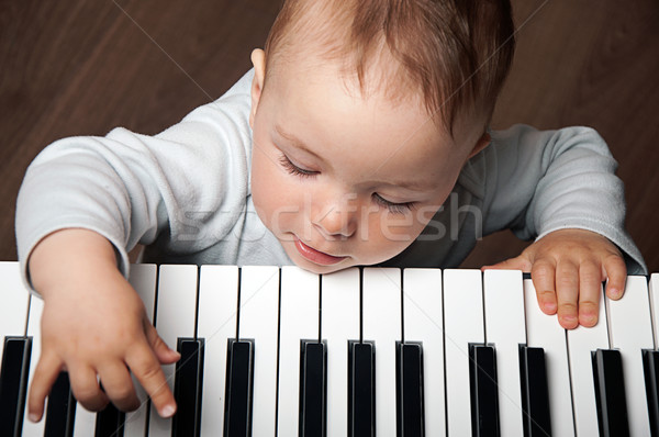 baby play music on piano keyboard Stock photo © vkraskouski