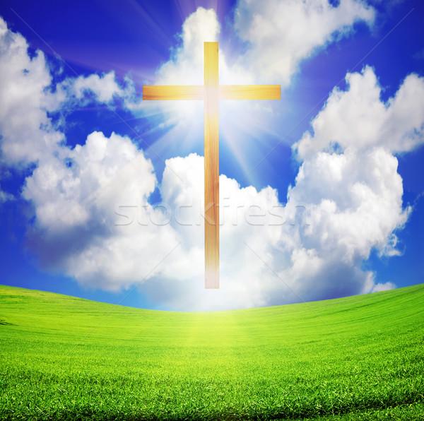 easter cross over green field and blue sky Stock photo © vkraskouski