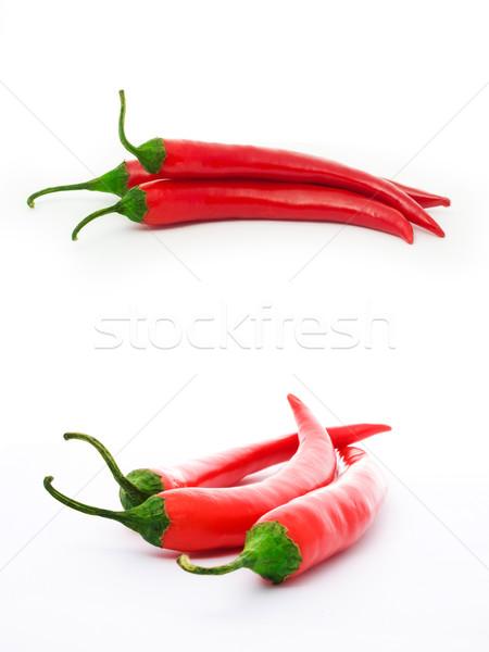 Vermelho pimentas três isolado branco comida Foto stock © vkraskouski