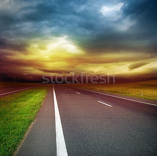 Aszfalt út mező viharos égbolt sötét Stock fotó © vkraskouski
