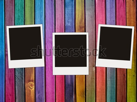 colorful wooden fence with three blank photos Stock photo © vkraskouski