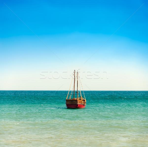 Barco mar céu vermelho blue sky azul Foto stock © vkraskouski