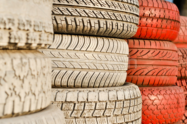 close up of racetrack fence of white and red of old tires Stock photo © vlaru