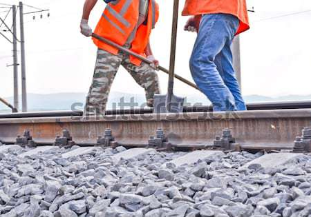 railway embankment, rails and workers in orange vests Stock photo © vlaru