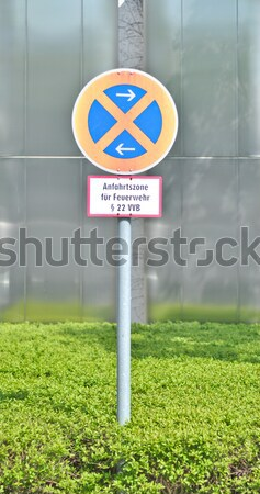 Traffic sign 'the stop is forbidden' against office building Stock photo © vlaru