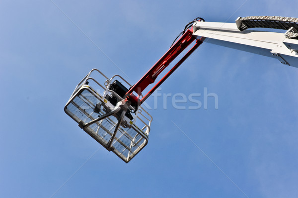 Stock photo: white hydraulic construction cradle against the blue sky