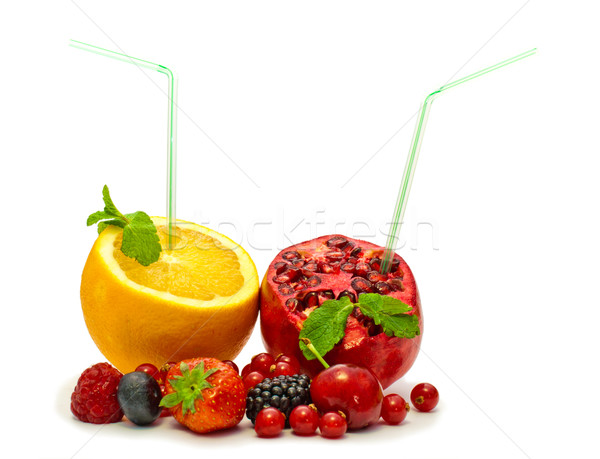 orange and pomegranate with a straw and berries on a white background Stock photo © vlaru