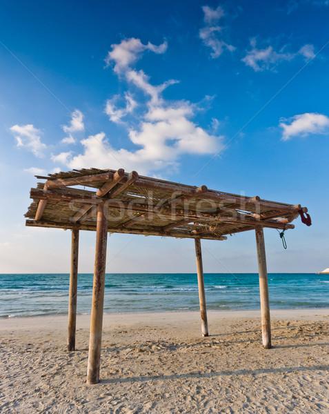 wooden canopy on the sandy beach and blue sky Stock photo © vlaru