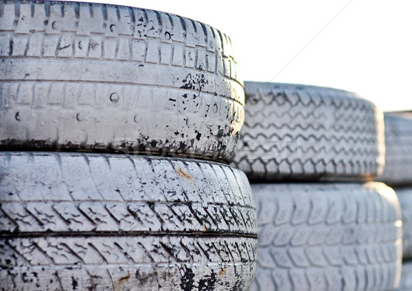 close up of racetrack fence of  white old tires Stock photo © vlaru