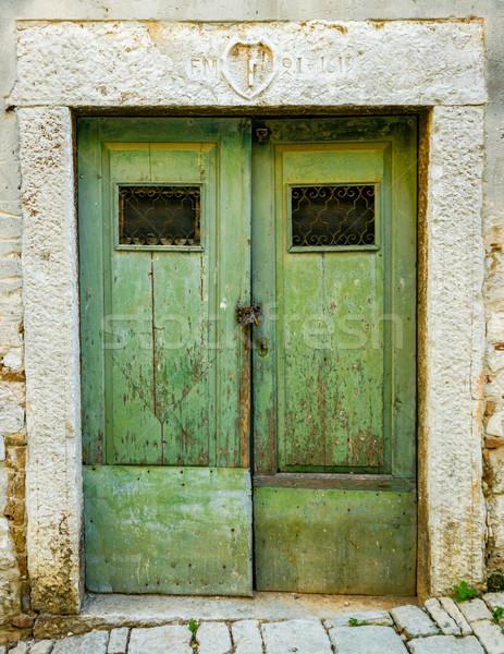 Vecchio verde legno porta ferro Foto d'archivio © vlaru