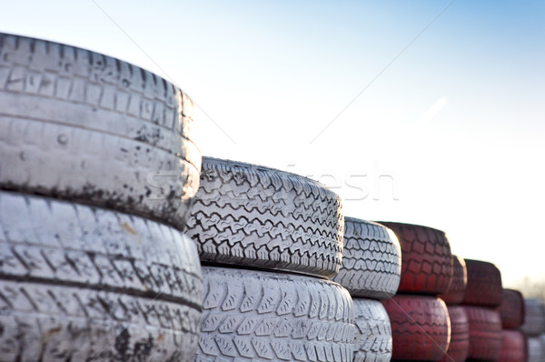 close up of racetrack fence of  red and white old tires Stock photo © vlaru