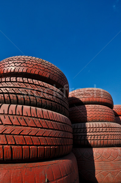 Stock photo: close up of racetrack fence of  red old tires
