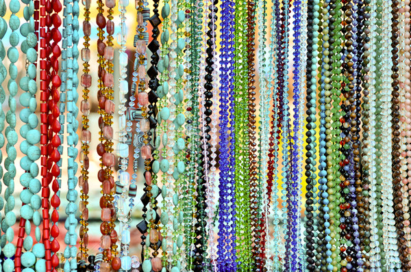 lots of colorful glass and stone beads hanging in a row Stock photo © vlaru